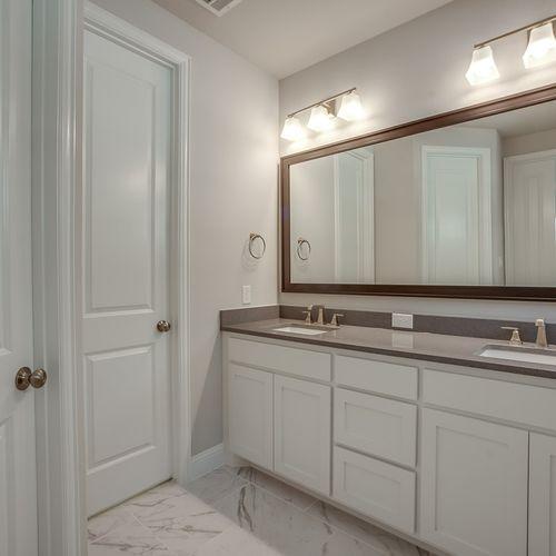 Plan 1120 Primary Bathroom Representative Image