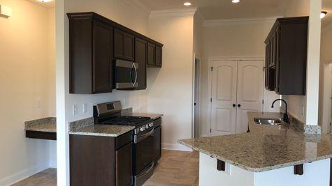 Kitchen and Desk Nook - Cedar Springs Community - DSLD Homes Gonzales