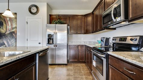 Kitchen with Espresso Cabinets and Stainless Steel Appliances  - Bridgewood - DSLD Homes D'Iberville