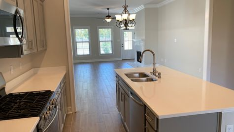 Kitchen, Dining and Living - Silver Oaks Community - DSLD Homes Gonzales
