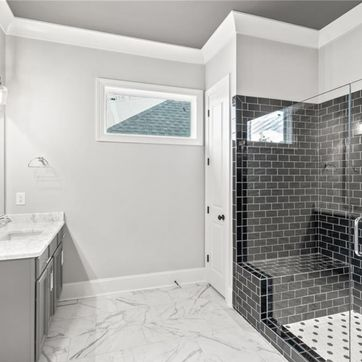 <p>Can you say bathroom goals??<br/><br/>Black &amp; White Hex Mosaic Tile for the Shower Floor &#128525;<br/>Contessa Floor Tiles &#128525;<br/>Black Subway Tiles for the Shower Wall &#128525;<br/>New Super White Quartzite Countertops &#128525;<br/><br/>Our 2,000 square foot Birmingham design studio is ideal for choosing the absolute best products and materials that fit your lifestyle, but it is also a superb place for inspiration. Future homeowners can create looks for their exteriors, kitchens, bathrooms, floors, lighting and much more. Follow the link in our bio to learn more about our Design Studio.<br/></p>
