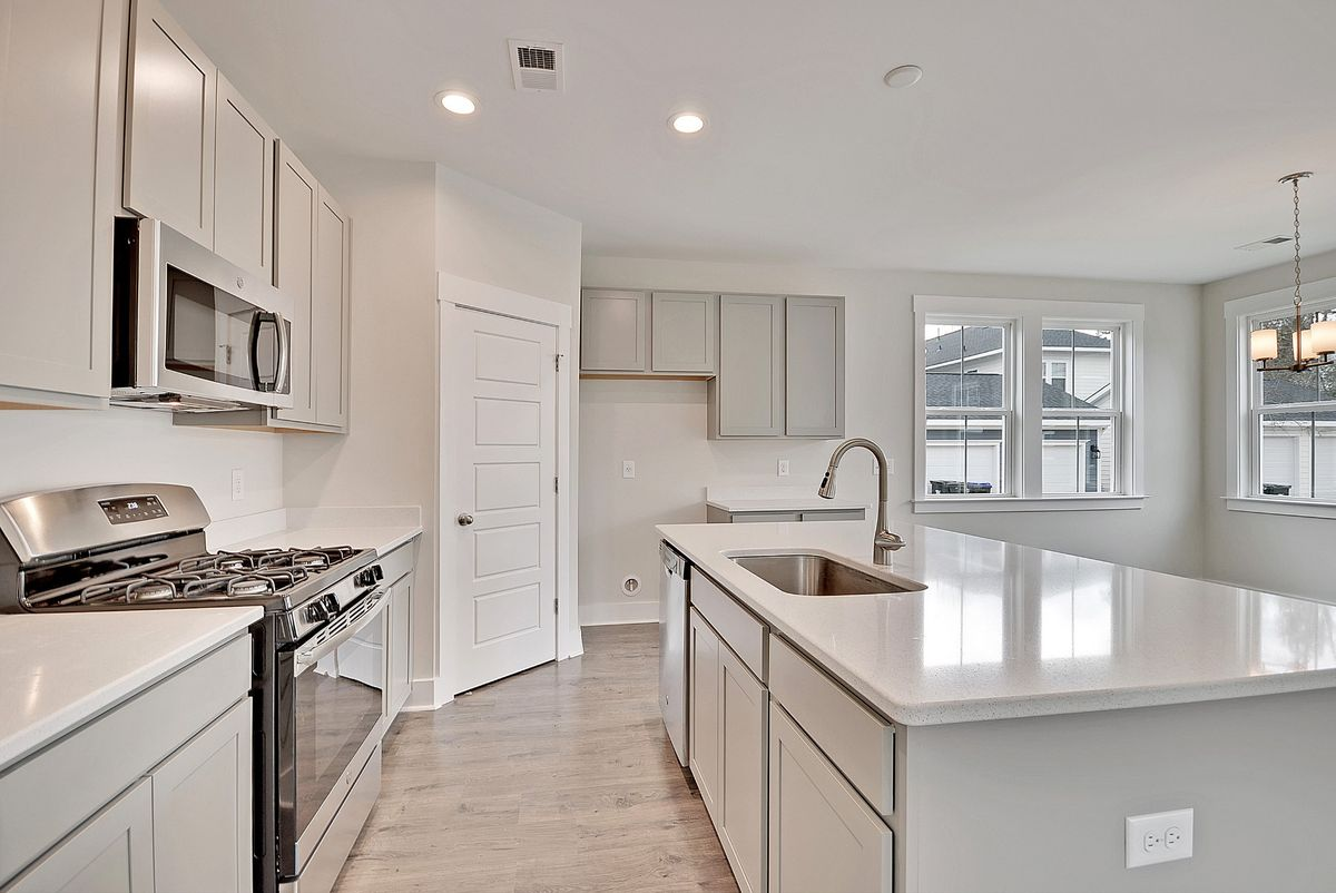 open kitchen with light gray cabinets