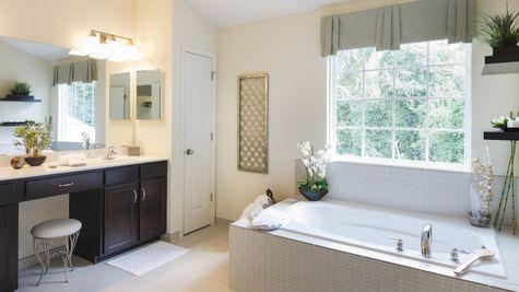 Baldwin master bathroom with soaking sub, large window, double sink vanity.