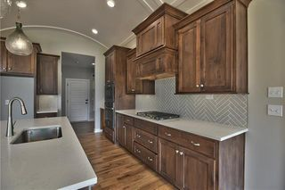 The Sonoma Reverse - Kitchen with Barrel Vault Ceiling, Quartz Countertop and Island and Upgraded Herringbone Tile Backsplash