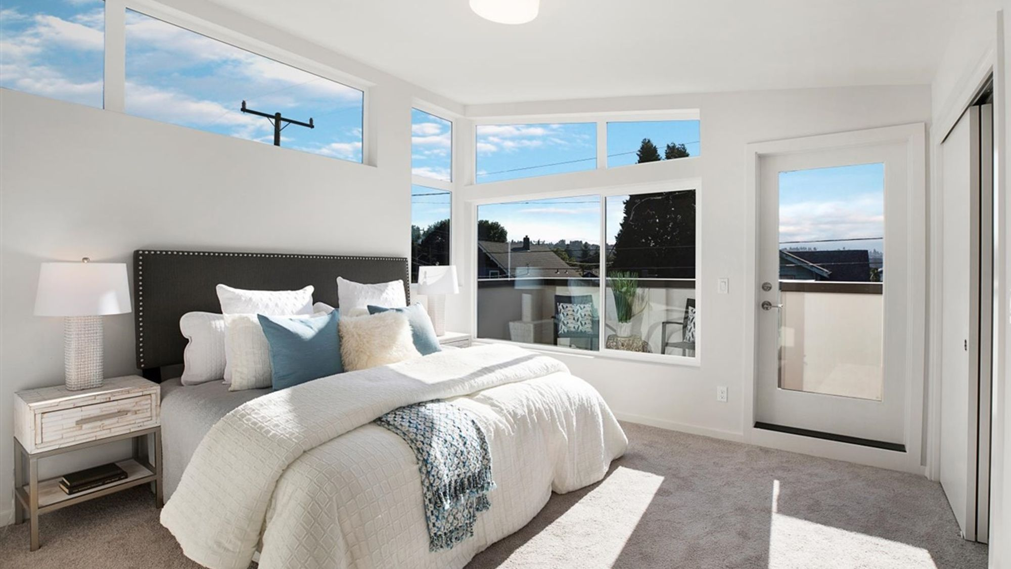 Master Bedroom and Deck of the Eero by Sage Homes Northwest