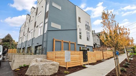 Exterior and Sidewalk in front of the Fuller at Post Square Townhomes in Hillman City by Sage Homes Northwest