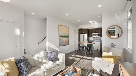 Living Room and Kitchen of the Eero at the Oxbow in Georgetown by Sage Homes Northwest