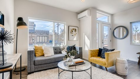 Living Room with Picture Windows of 7626 6th Ave NW in Phinney Ridge by Sage Homes Northwest