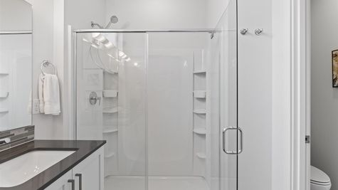 Primary Bathroom Shower of the the Alvar at the Watermark at Highland Park by Sage Homes Northwest